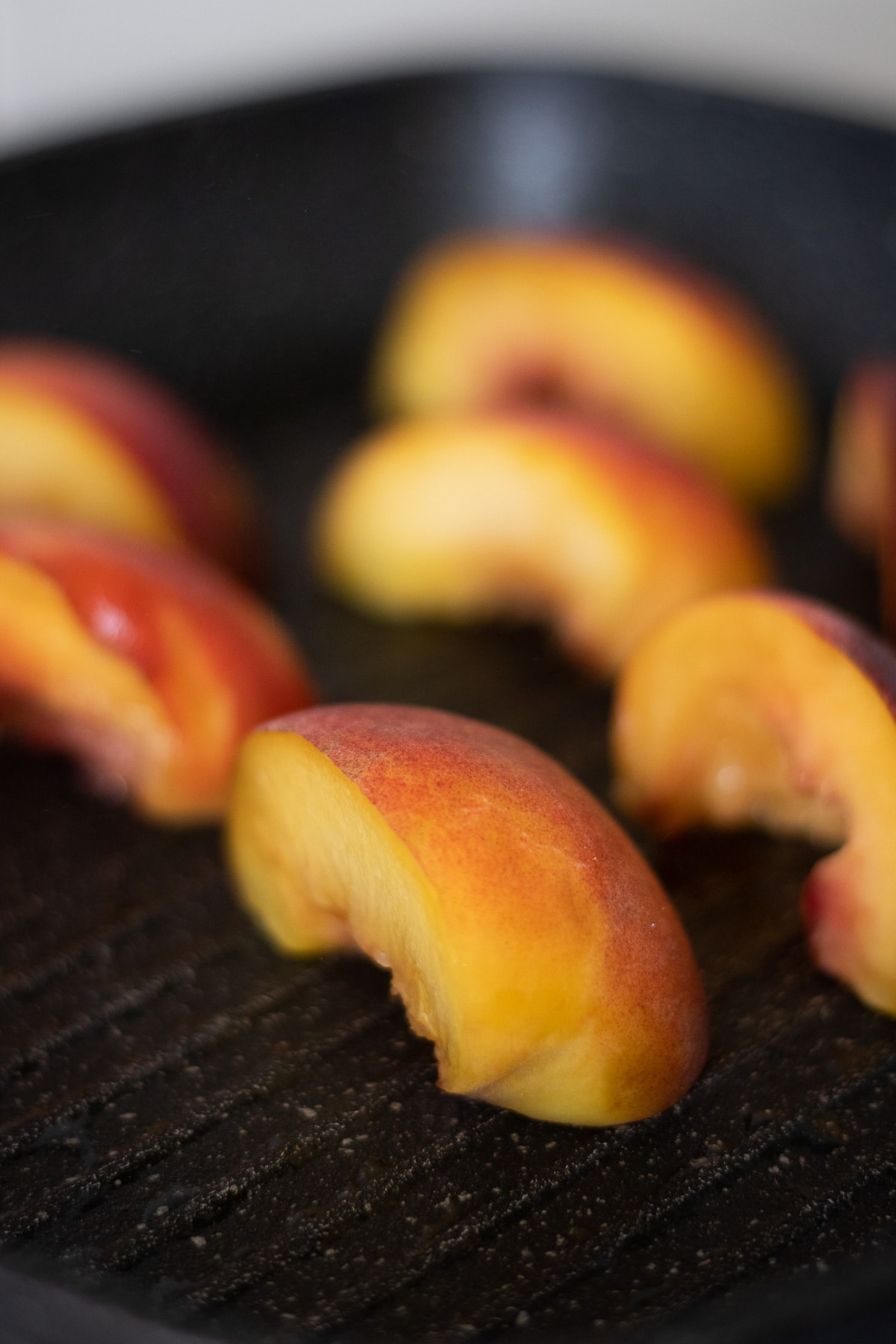 Close up of peaches being grilled