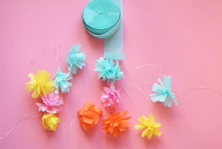 Make a beautiful paper flower wreath out of crepe paper. This is the perfect DIY spring wreath!