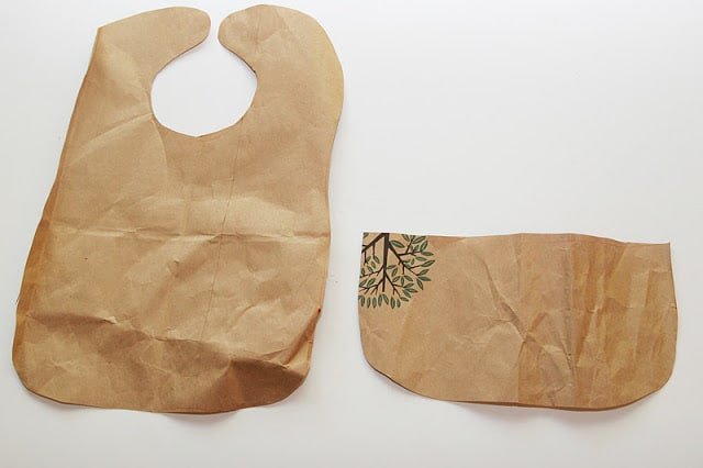 Make an easy bib from a reusable shopping bag! It's waterproof, cheap and a super easy DIY bib to make for gifts!
