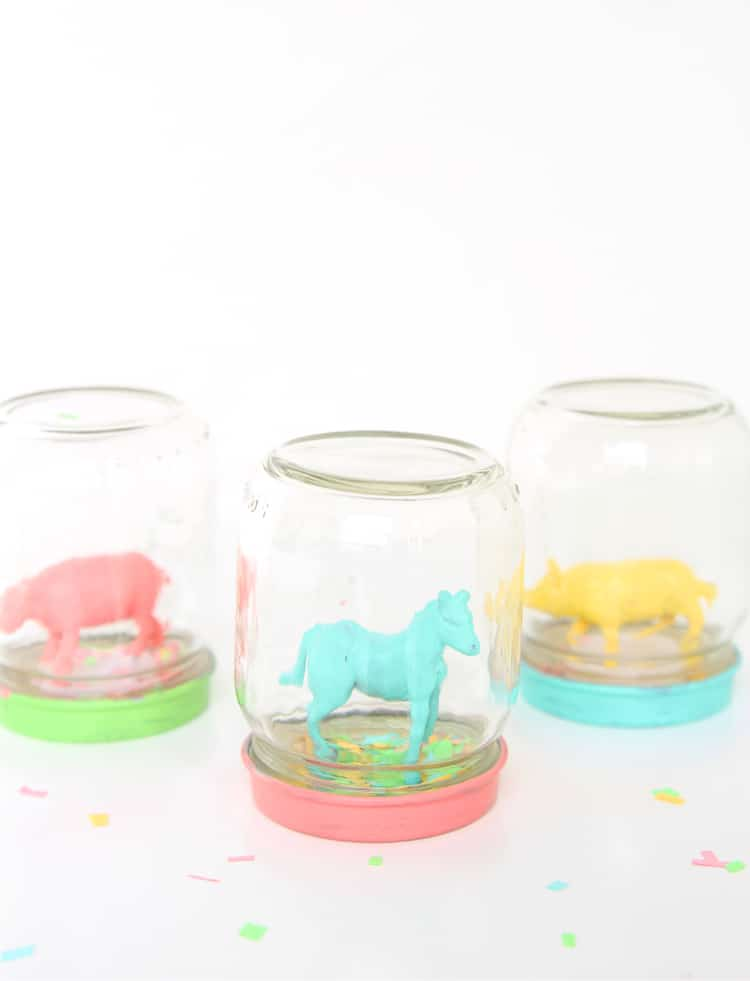 These DIY snow globes are perfect for spring or summer. Instead of snow, use bright colored confetti and place painted animals or other small toys on the inside