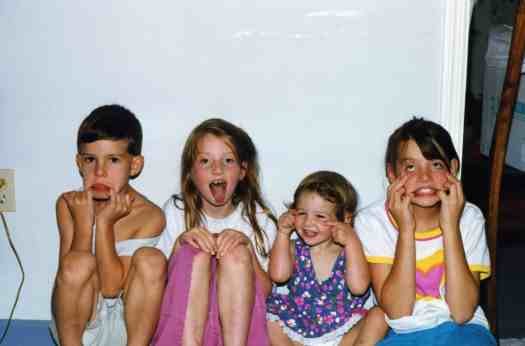 Home schooling help for parents: Four children making silly faces. Yes, this is what my home school looked like some days!
