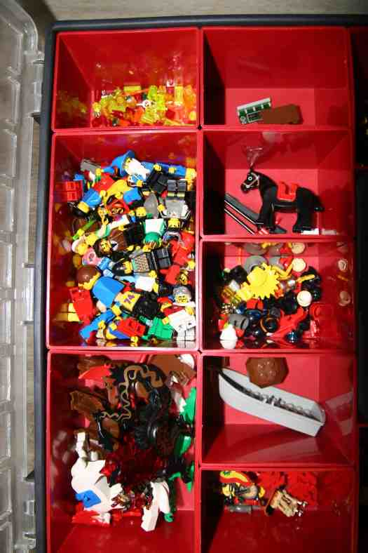Lego pieces divided into tool box organizer