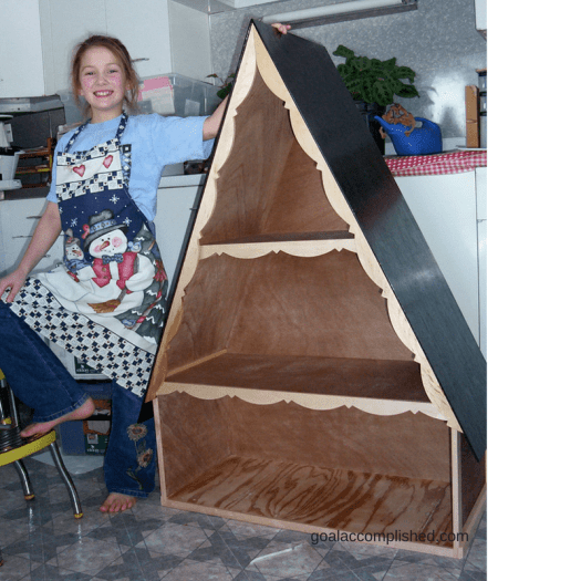 "Father's Day Tribute: Picture shows a smiling 6 year old girl with the ""A""-frame dollhouse she built with her dad."