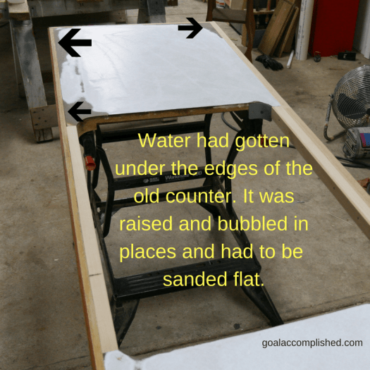 The arrows show where water had gotten under the old laminate and raised up the wood. These areas needed to be sanded flat.