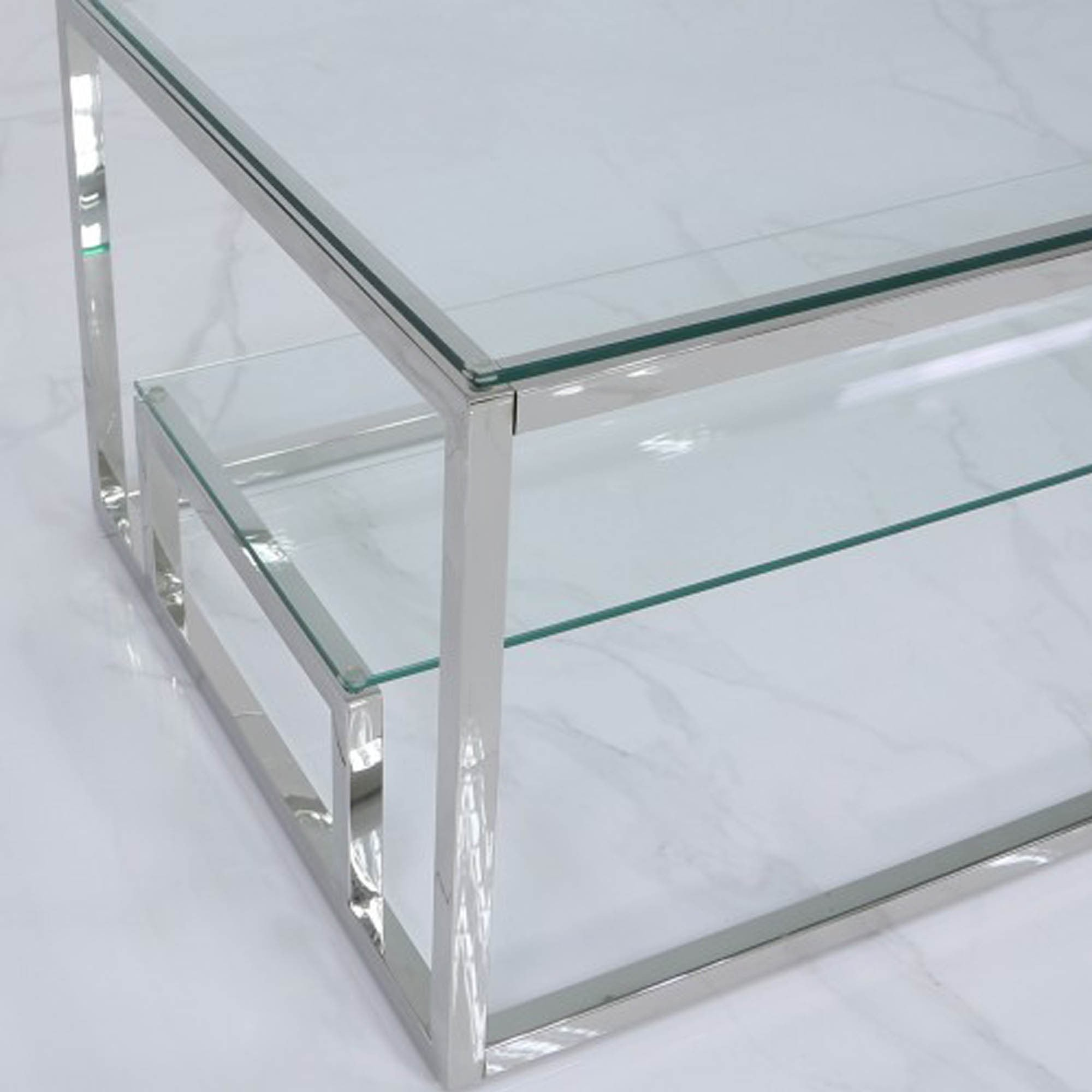 harry steel and clear glass tiered coffee table