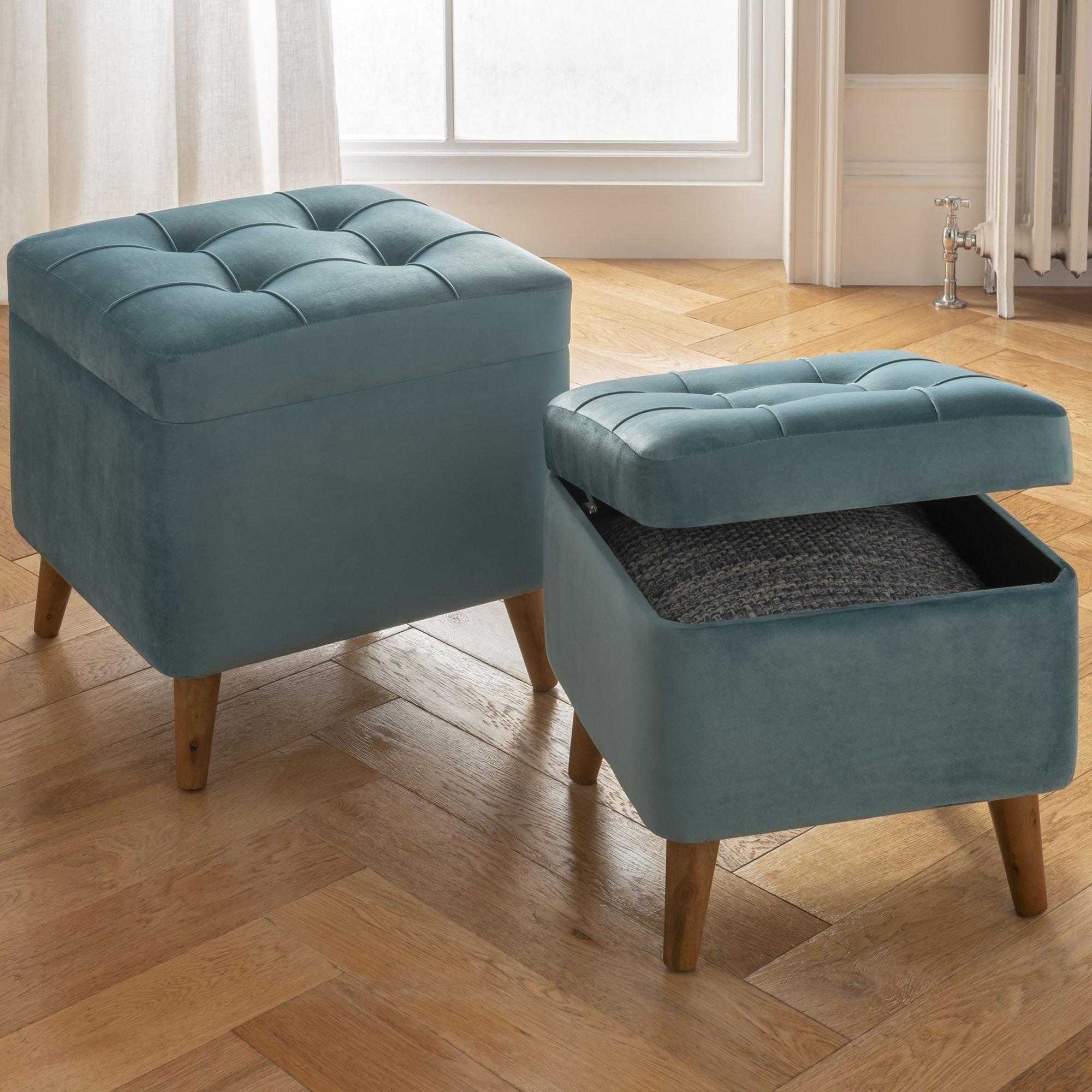 pair of teal storage footstools