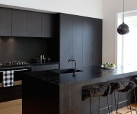 A matte black kitchen makes a bold statement in this ...