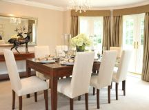 8-person dining room table in formal dining room.