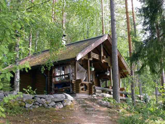 A pretty log cabin in the woods (Finland)