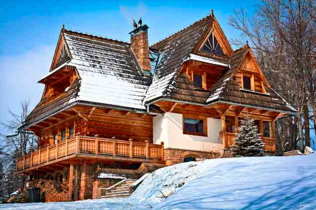 Swiss style log mansion with huge covered deck.