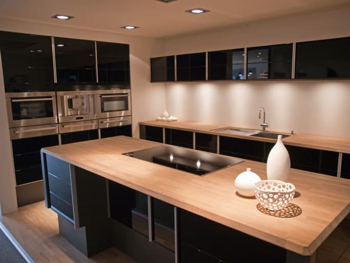 modern kitchen images large tables 39 design ideas photos example with black flat panel cabinets and warm wood countertops
