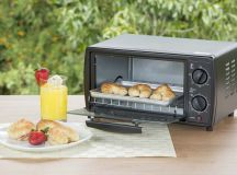 Small toaster oven on outdoor dining table.