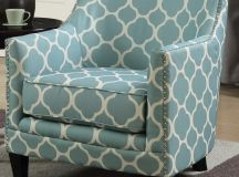 Green and white accent chair.