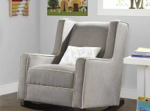 Gray rocking chair with throw pillow.