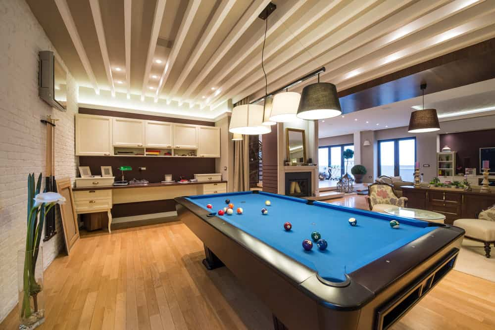 Felt stuck when trying to fit a big billiards table into a small room? 65 Rooms with a Pool Table (Man Caves Included)