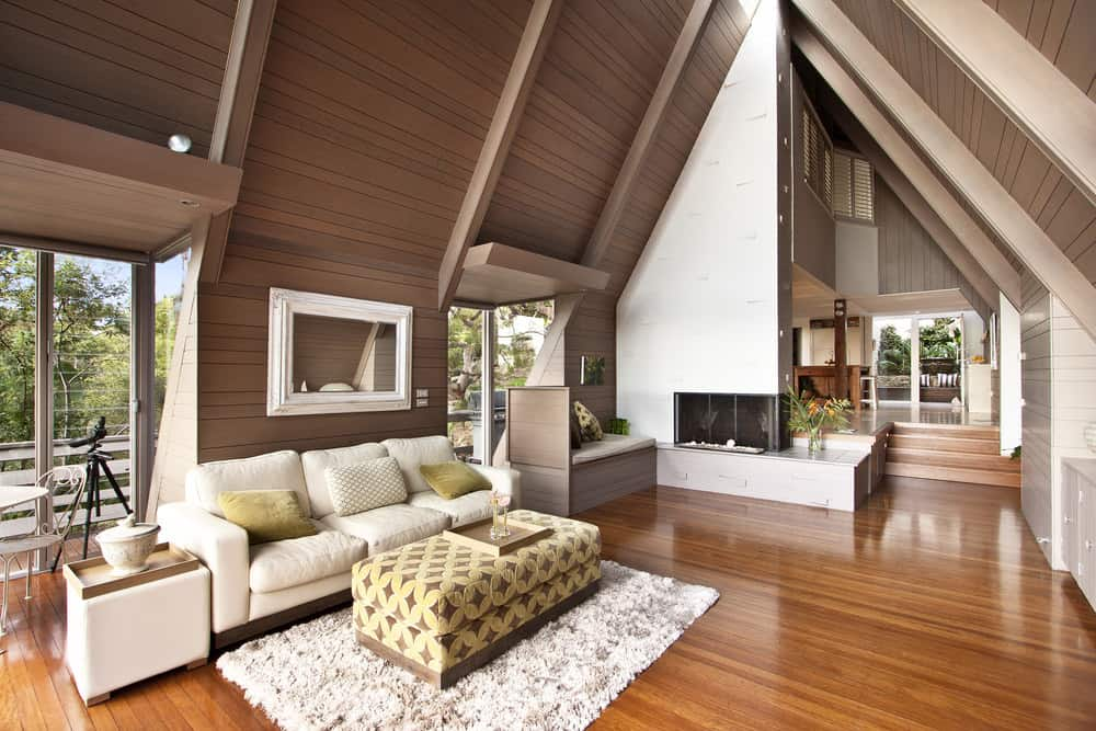 living room decor with hardwood floors gray paint for small 41 rooms pictures this gorgeous modern uses warm orange toned flooring to contrast the cooler brown paneling cream colored furniture and soft