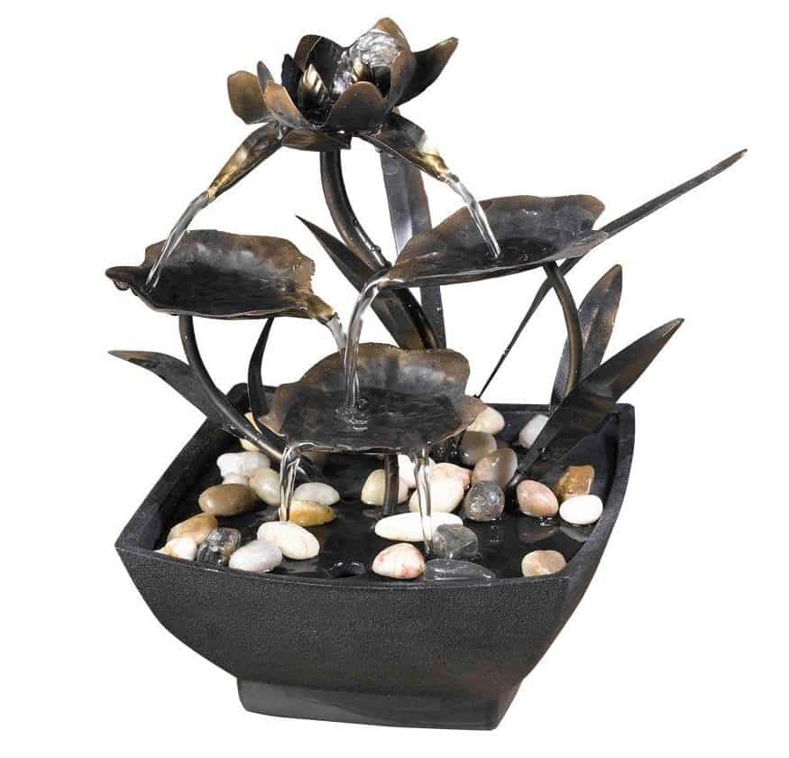 Small, table-top fountain with metal leaves.