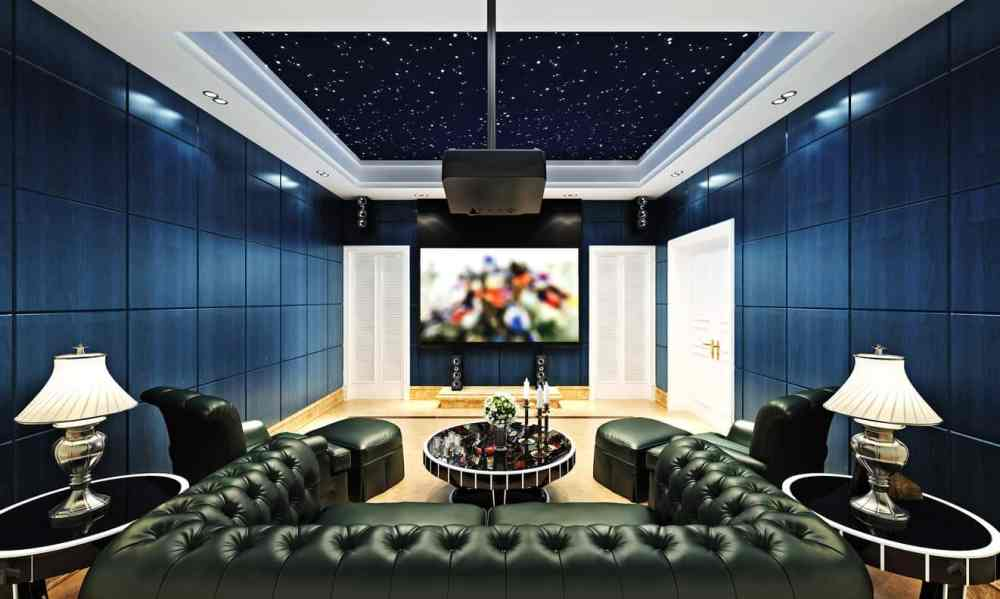 medium resolution of cool home theater with blue walls and huge u shaped tufted sectional sofa