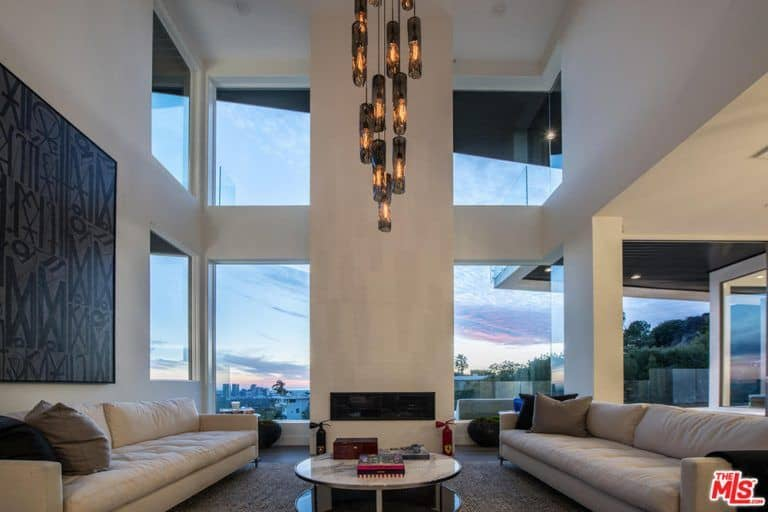 ideas for living room modern paint colors rooms with dark brown furniture 64 stylish photos the features a towering high ceiling and grand chandelier along modish