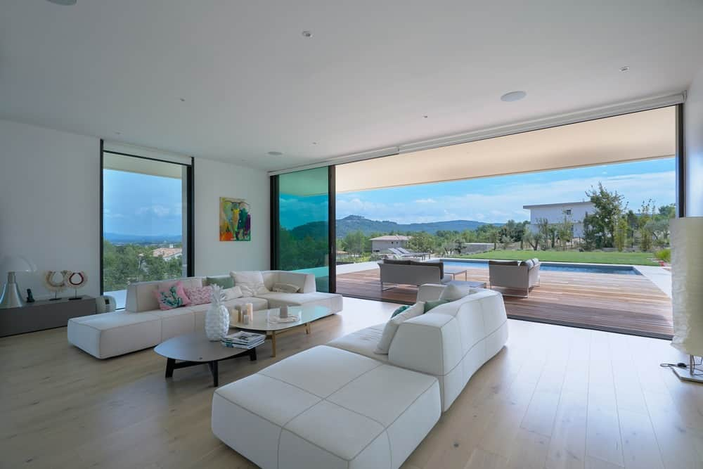 modern living room decor 2018 wall mounted tv ideas 64 stylish photos this breezy overlooking the pool gives a very beachy vibe thanks to its neutral