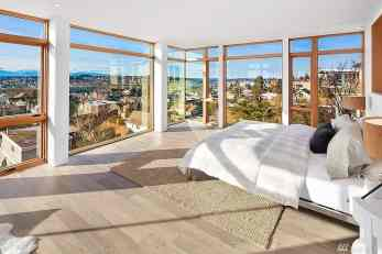 Incredible modern master bedroom with city views