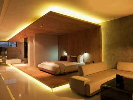 This modern bedroom is very interesting. I realize very few people would opt for this design, but it is unique in how it turns the bedroom into a stage surrounded by very cool lighting. Interesting to say the least.