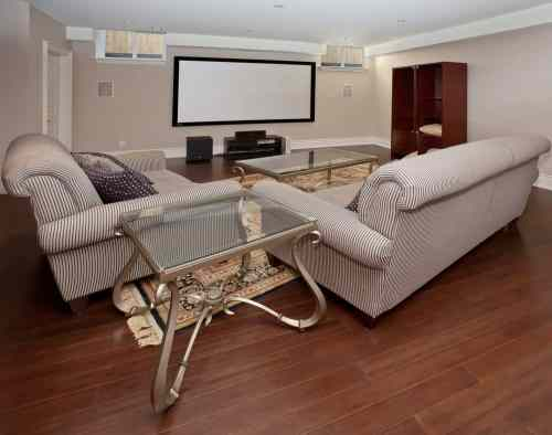 small resolution of large home theater featuring cozy sofa set on top of the hardwood flooring
