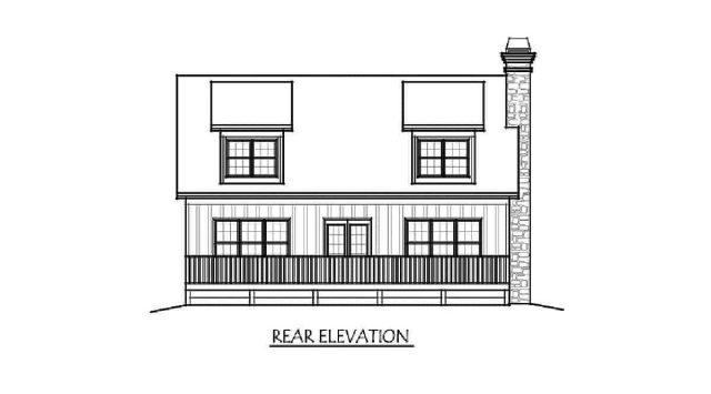 4 yatak odalı iki katlı evin arkadan görünüş çizimi.