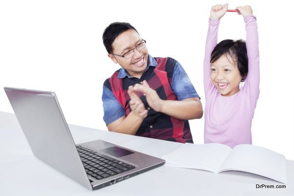Happy girl with dad and laptop