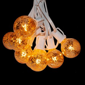 Mercury string lights lit on white wire