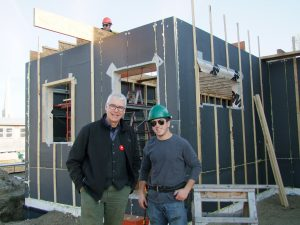 Photo by Chris Must: Chris Hahn, dean of the Perth Campus of Algonquin College, left, chats with second-year construction carpentry student Ryan Dozzi on the site of Habitat for Humanity's first Perth home.