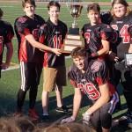 Local athletes lead football team to perfect season