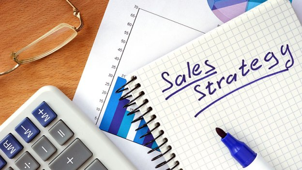 Sales strategy written in lined paper.