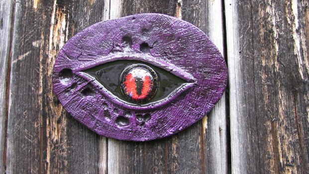 Purple circle with black and red eye.