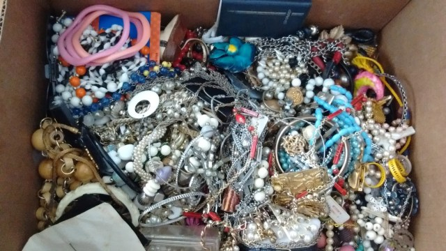 Box of tangled jewelry found at Livingstonville Flea Market.