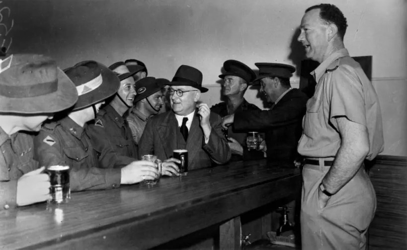 StateLibQld_1_210446_Soldiers_having_a_drink_at_the_Army_Service_Club_canteen_wet_bar,_Brisbane,_1942