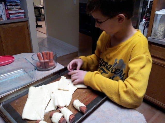 Mister Man preparing bagel dogs