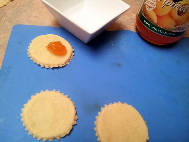 Apricot cookies getting the preserves added