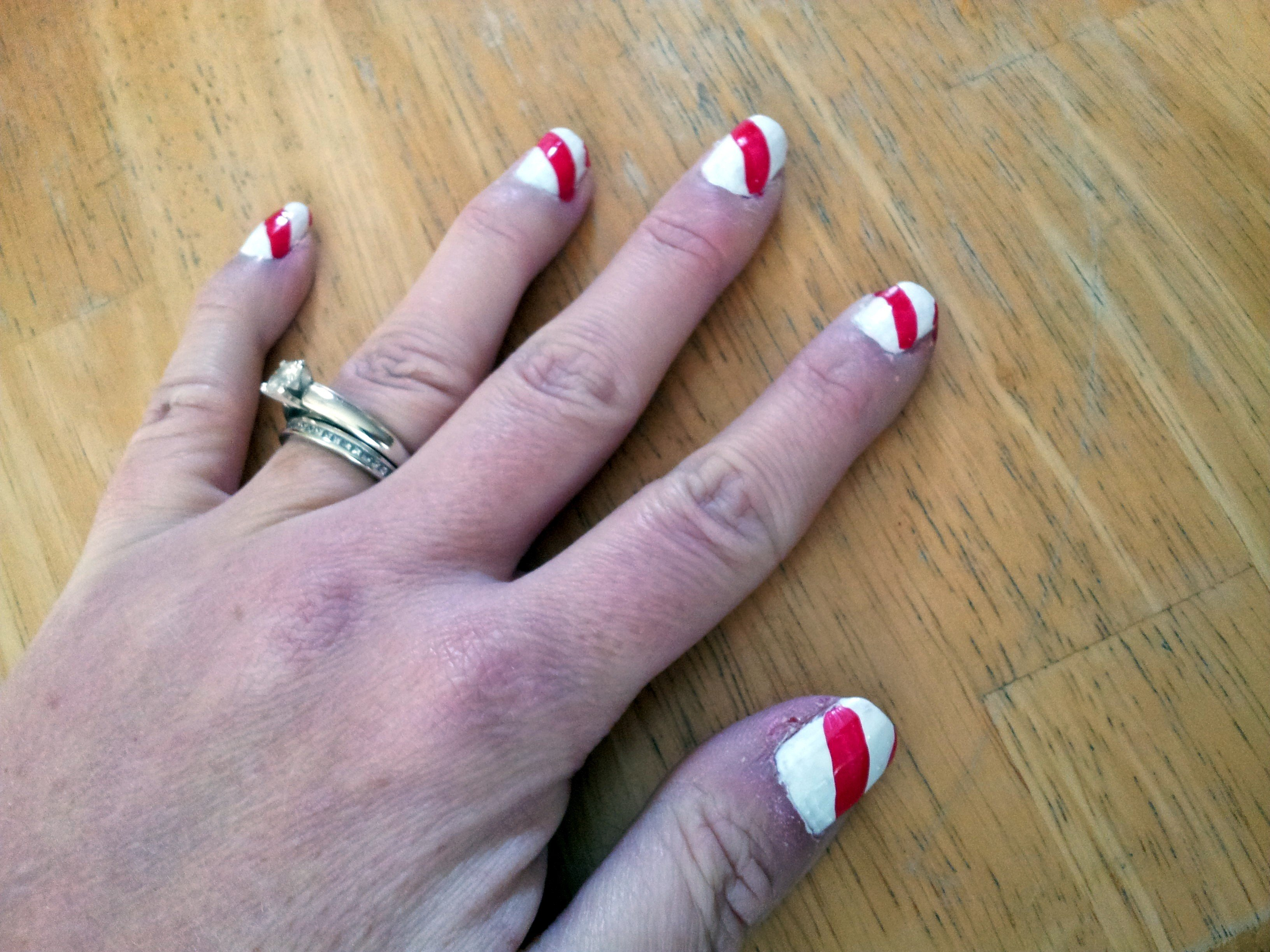 Candy cane nails with red stripe