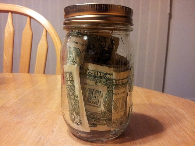 Jar filled with money as incentive