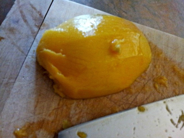 Mango peeled and removed from the pit