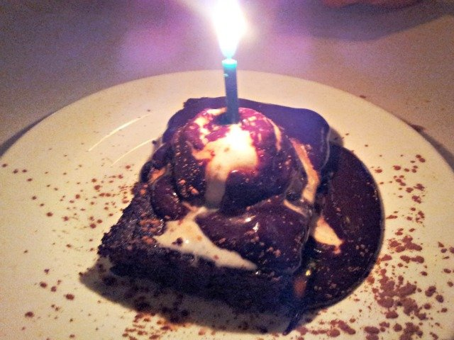 anniversary chocolate dessert at a restaurant with a candle