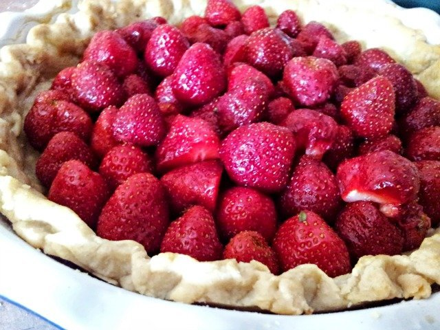 Pie with strawberries ready to be glazed