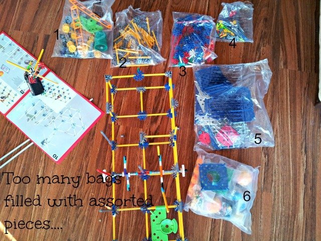 Six bags filled with K'NEX pieces in a random order