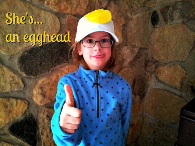 Create a quick and simple egghead costume with a white ball cap and a yellow paper yolk