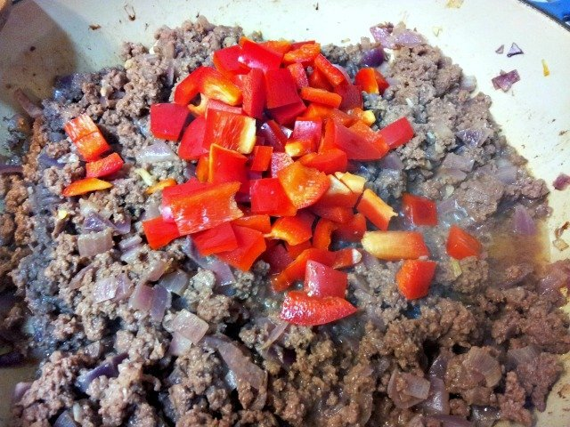 Red peppers are added after most of the cooking is done to ensure they stay slightly crunchy
