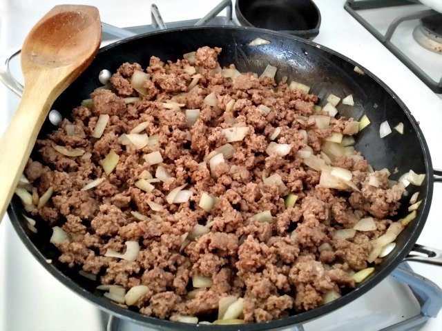 Fully browned ground beef is ready to be mixed with tomatoes