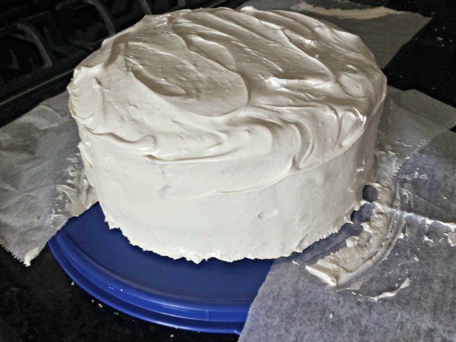 Remove parchment paper strips once your cake is decorated for a clean cake plate
