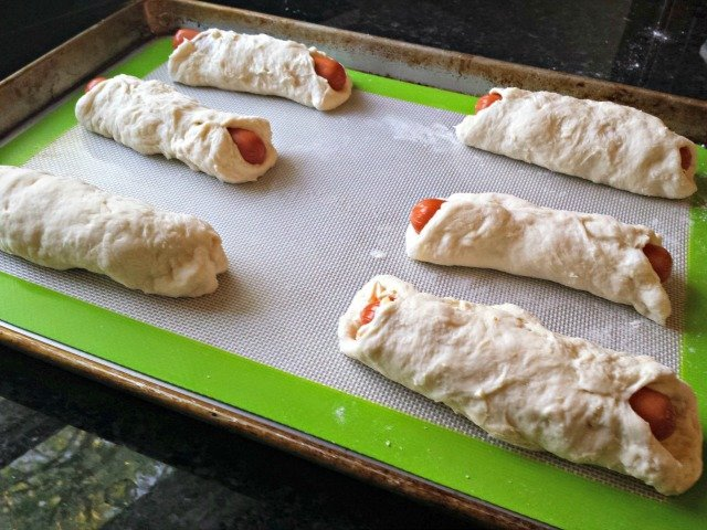 Baking cheesy stuffed bagel dogs