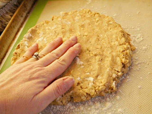 Pat scone dough into circle